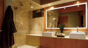 A bathroom Installed with Grand Mirrors Lighted Mirror